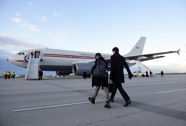 Prime Minister Justin Trudeau and son Xavier depart Ottawa on Monday, Dec. 2, 2019. Trudeau flies to London today to celebrate the 70th birthday of the NATO military alliance, which is facing questions and uncertainty about how to deal with Russia, China — and its own internal divisions. THE CANADIAN PRESS/Sean Kilpatrick