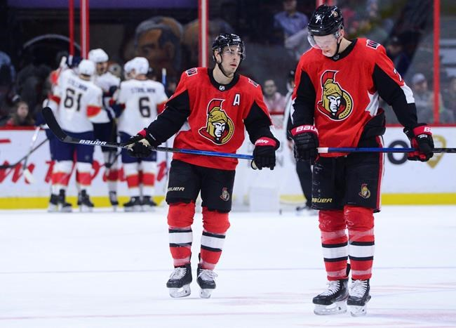 Florida Panthers, back, celebrate a goal as Ottawa Senators centre Jean-Gabriel Pageau (44) and teammate Brady Tkachuk (7) make their way to the bench during second period NHL action in Ottawa on Thursday, Jan. 2, 2020. THE CANADIAN PRESS/Sean Kilpatrick