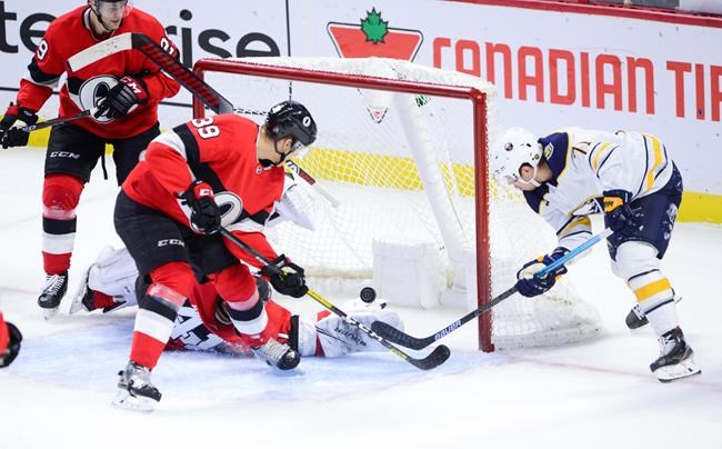 Ottawa Senators goaltender Craig Anderson (41) makes a save with his blocker as Buffalo Sabres left wing Evan Rodrigues (71) attempts to get the puck in the net during third period NHL action in Ottawa on Monday, Dec. 23, 2019. THE CANADIAN PRESS/Sean Kilpatrick