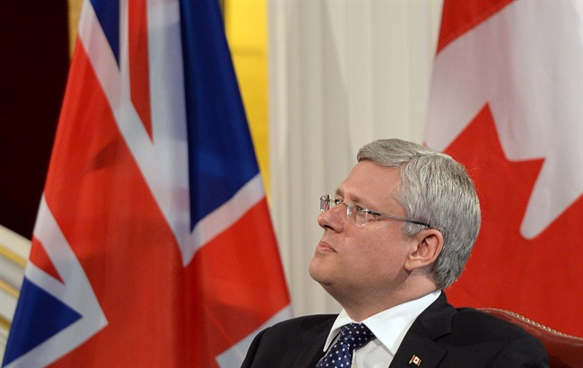Prime Minister Stephen Harper takes part in an economic question and answer session at Mansion House in London, England on Wednesday Sept. 3, 2014. THE CANADIAN PRESS/Sean Kilpatrick