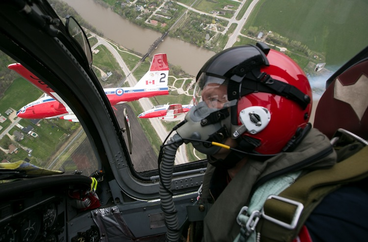Captain Gregg Wiebe, of Kenora, Ontario, pilots Snowbird 4 in the skies north of Winnipeg on Saturday. The Canadian Forces Snowbirds flew in formation over towns north of Winnipeg Saturday and will fly over the Forks and other areas south of Winnipeg on Sunday. (Melissa Tait / Winnipeg Free Press)