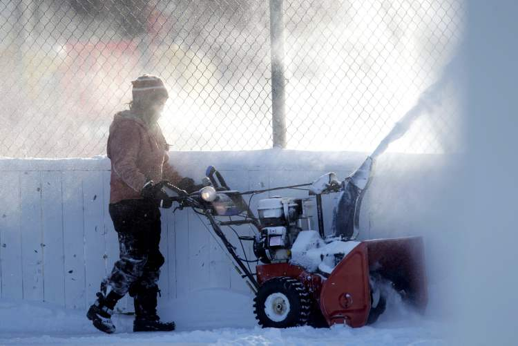 Barbara Choboter is the lucky caretaker for Bord-Aire Community Centre on Hampton Street who was charged with the task of blowing out all the snow from the rinks in the bitter cold Monday.