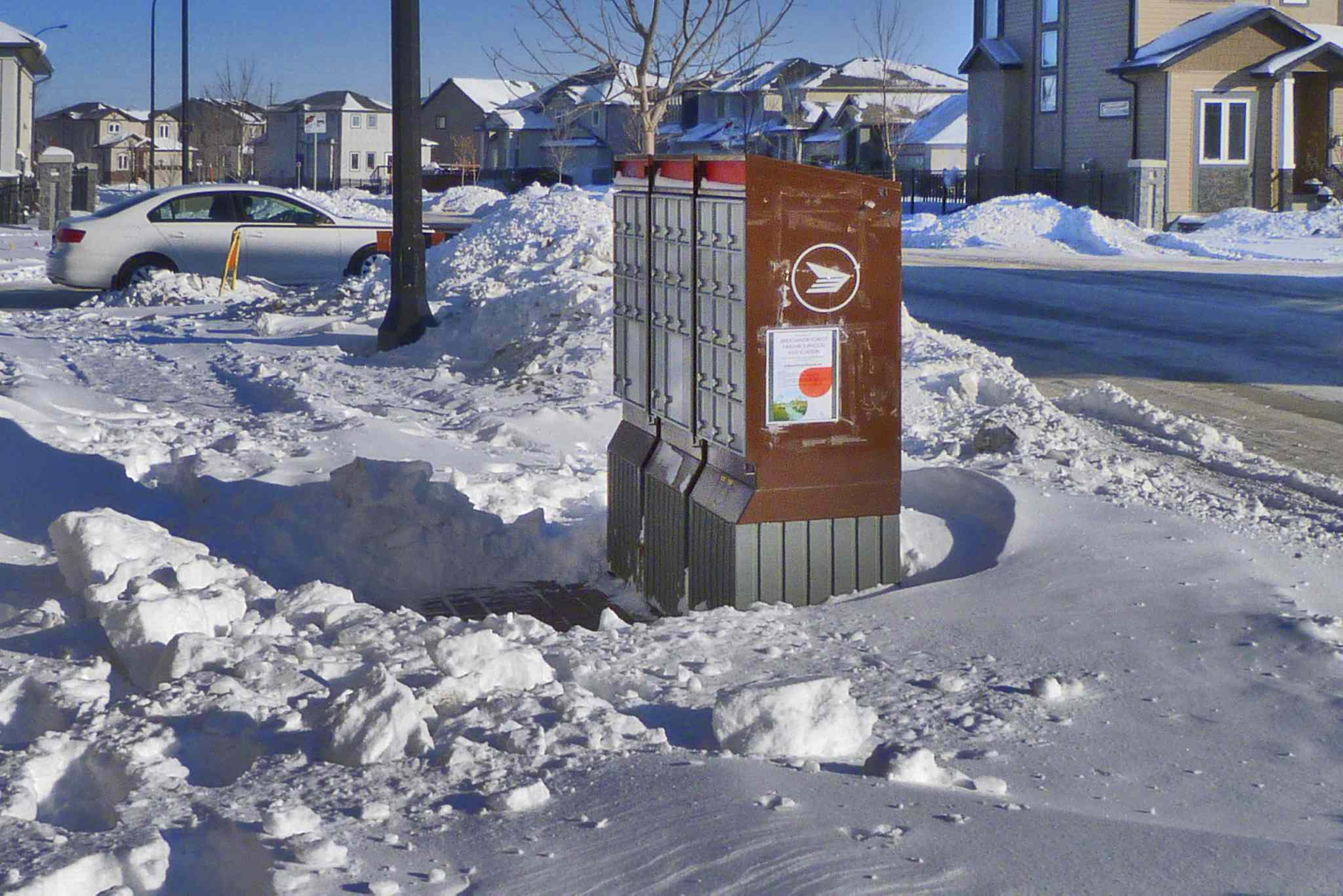A city report says it is Canada Post's responsibility to clear windrows of snow at community mailboxes.