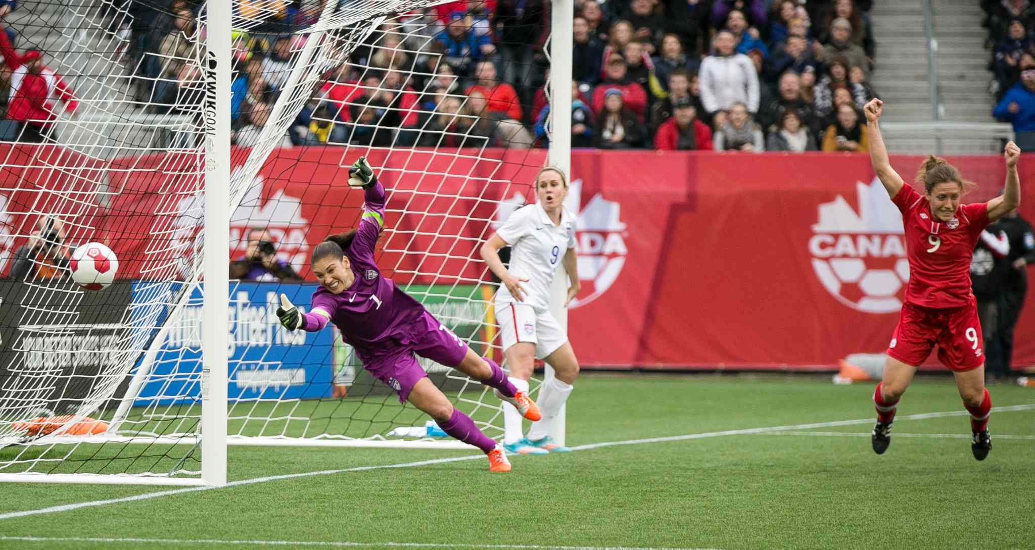 Canada forward Josée Bélanger, right, celebrates defender Kadeisha Buchanan's goal against USA goalie Hope Solo that put Canada up 1-0 in the first half.