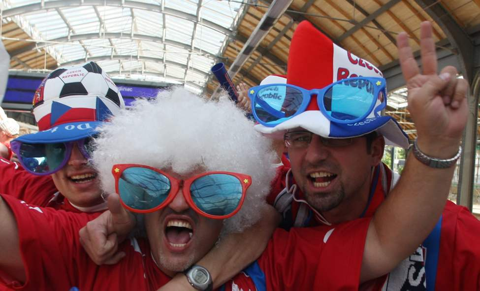 Czech Republic's fans shout as they arrive at the train station for the Euro 2012 soccer championship Group A match between Russia and Czech Republic in Wroclaw, Poland, Friday, June 8, 2012. (Petr David Josek / The Associated Press)