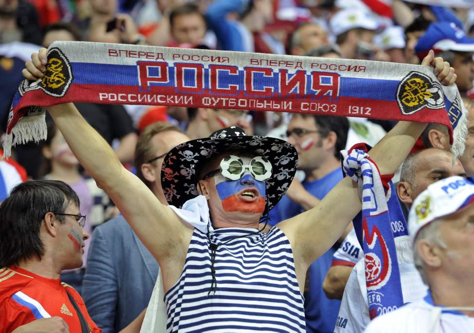 Russian fan cheers before the Euro 2012 soccer championship Group A match between Poland and Russia in Warsaw, Poland, Tuesday, June 12, 2012. (AP Photo/Alik Keplicz)