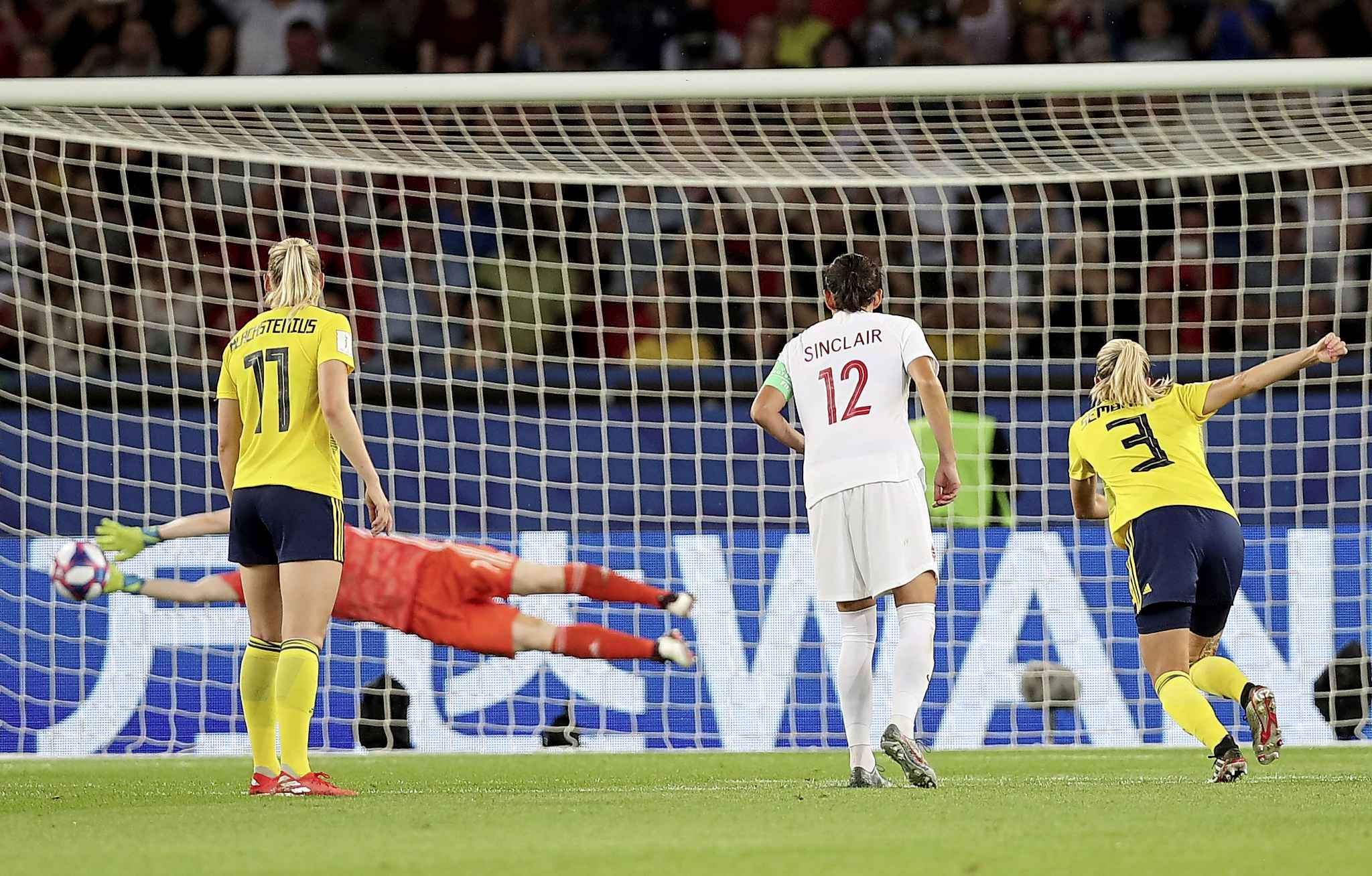 Sweden goalkeeper Hedvig Lindahl, left, makes a save on a penalty shot during the Women's World Cup match between Canada and Sweden as team Canada captain Christine Sinclair looks on, in Paris, Monday.