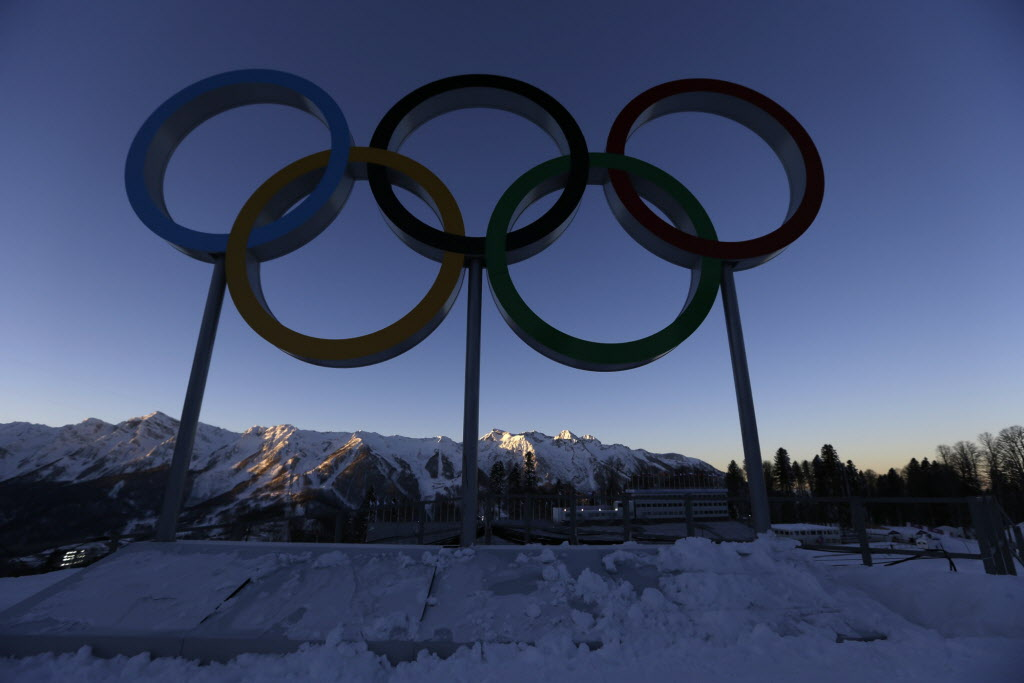 The sun rises over the Olympic rings at the Biathlon centre before the 2014 Winter Olympics on Thursday in Krasnaya Polyana, Russia.