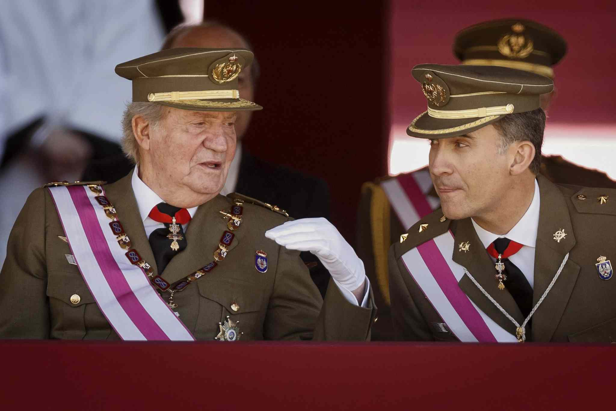 King Juan Carlos and Crown Prince Felipe, right, attend a military ceremony in San Lorenzo de El Escorial, outside Madrid, Spain, Tuesday.