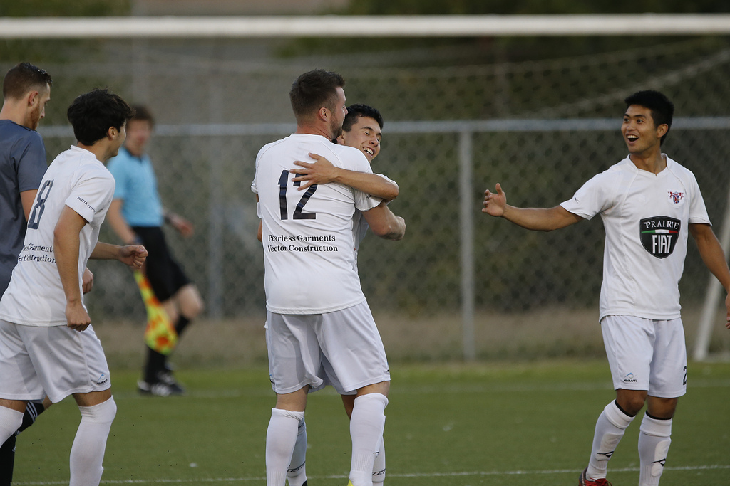 Players neglect the back-to-play rules when celebrating a goal at Ralph Cantafio Soccer Complex in Winnipeg Wednesday.