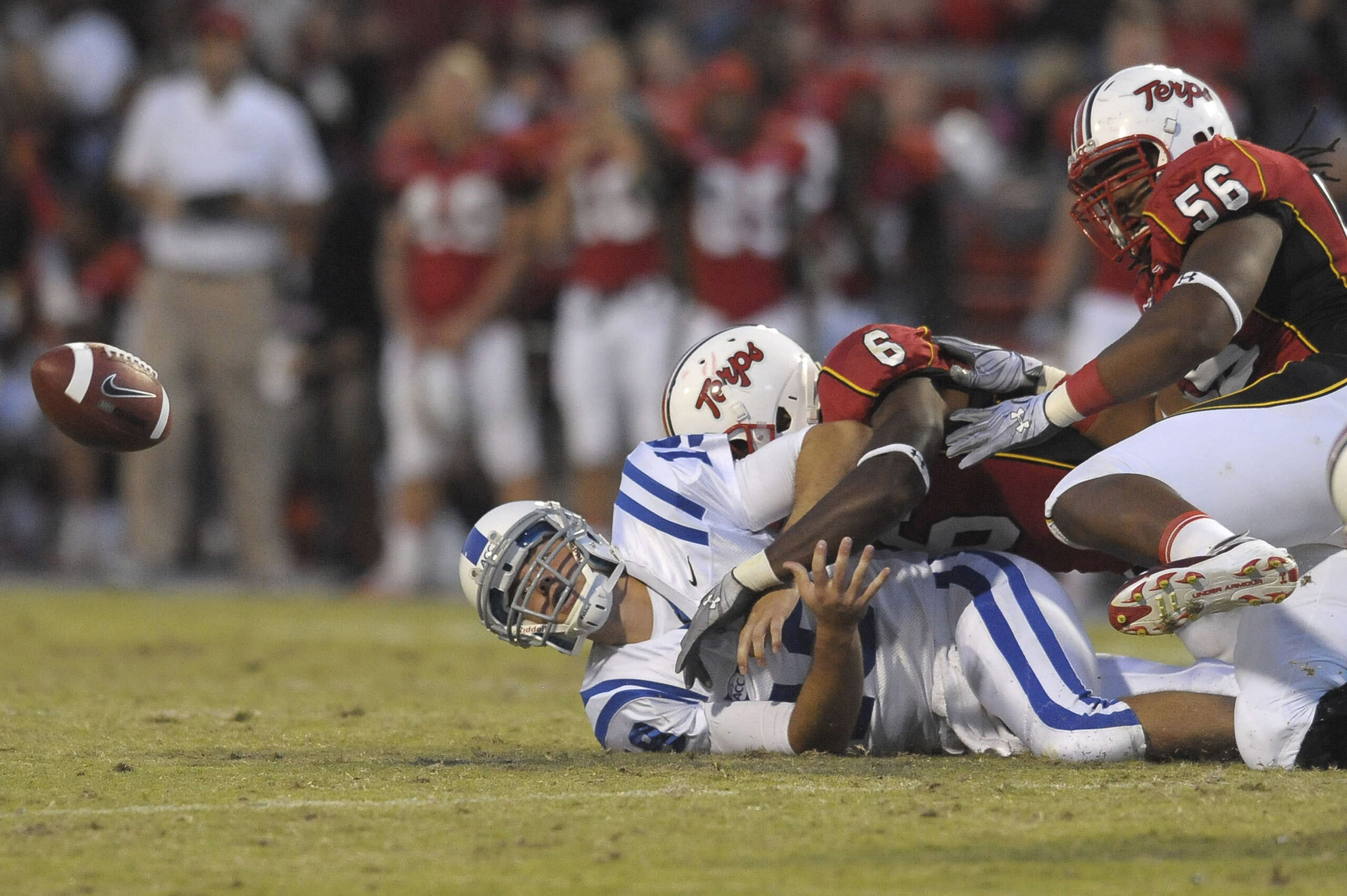 Maryland's Kenny Tate sacks Duke quarterback Sean Renfree causing a fumble in second-quarter action in 2010 in College Park, Maryland.