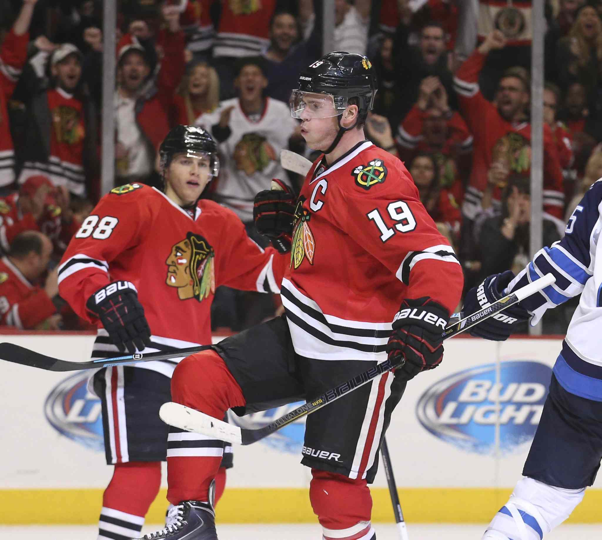 Jonathan Toews (19) of the Chicago Blackhawks celebrates his goal against the Winnipeg Jets during the first period.