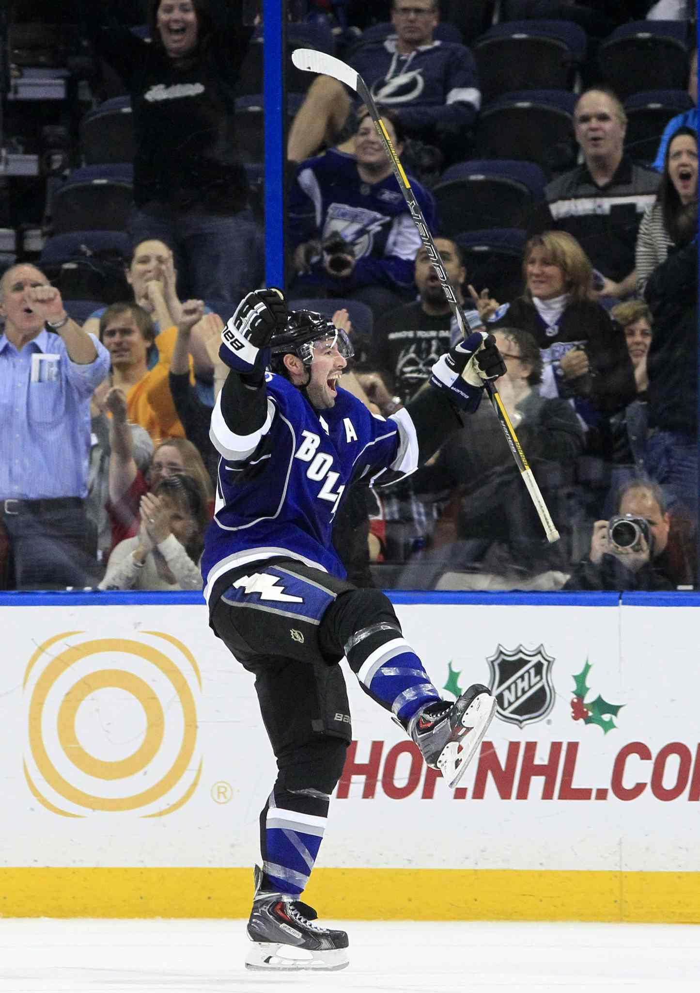 The Tampa Bay Lightning's Nate Thompson celebrates after scoring with 0.2 seconds left in the second period.