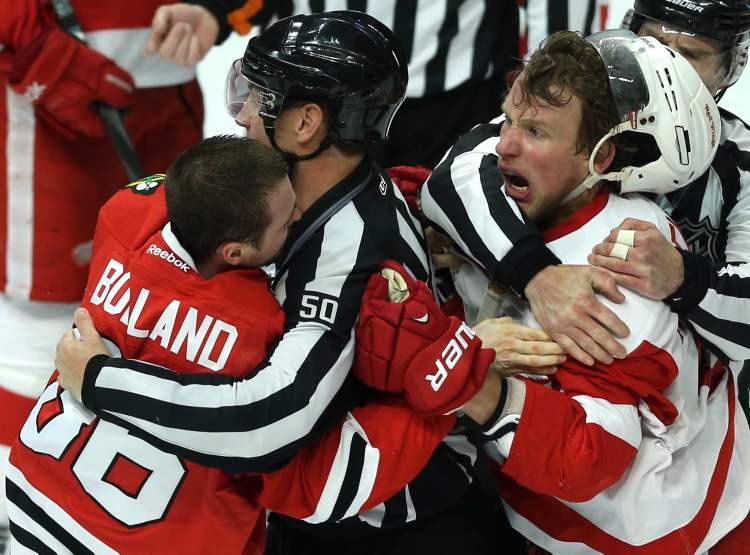 Chicago's Dave Bolland (left) and the Detroit's Justin Abdelkader get into it in the second period of Game 1.