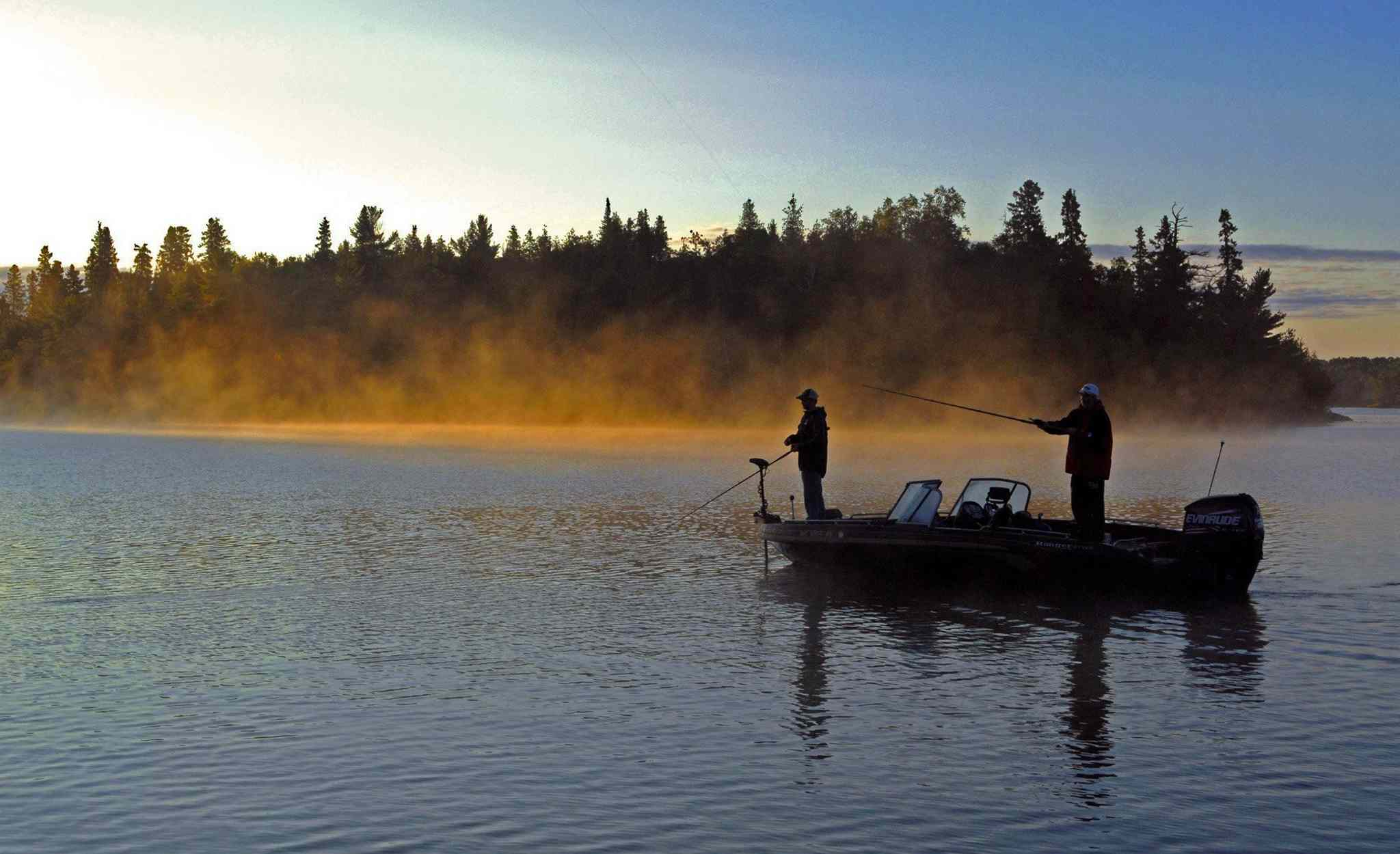 Fishers get to work at sunrise on Lake of the Woods in a file photo.