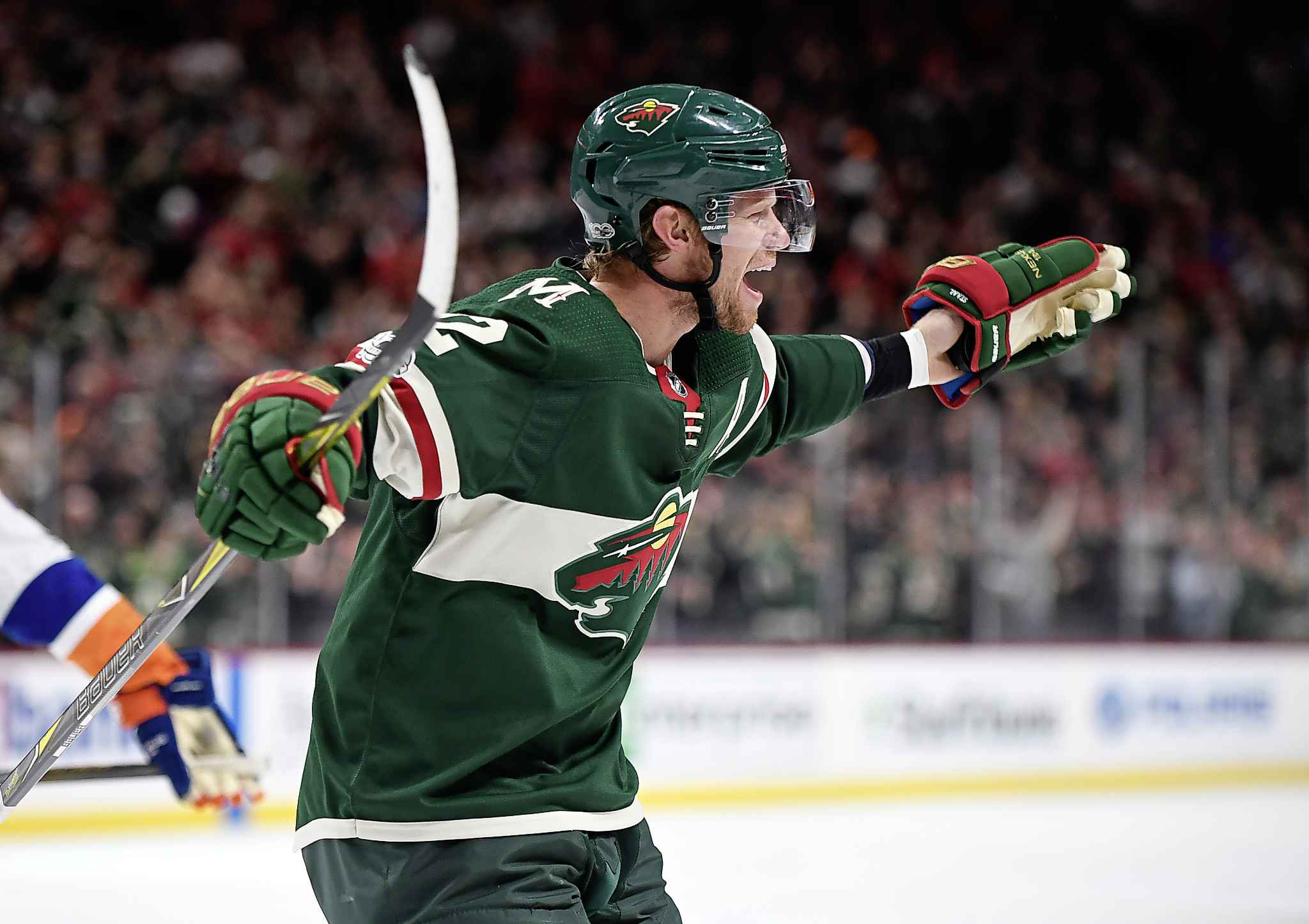 The Minnesota Wild's Eric Staal (12) joins the celebration after Luke Kunin, not pictured, scored his first NHL career goal in the second period against the New York Islanders on Thursday, Oct. 26, 2017, at Xcel Energy Center in St. Paul, Minn. (Aaron Lavinsky/Minneapolis Star Tribune/TNS)