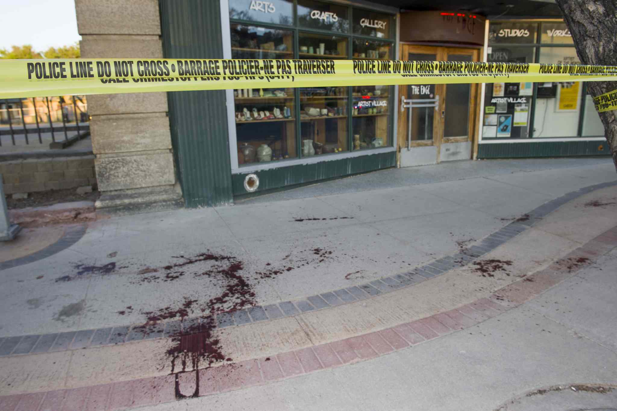 Blood spatters can be seen on the east sidewalk of Main Street between Alexander and Logan avenues.