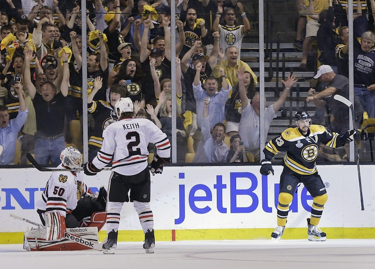Chris Kelly celebrates his first-period goal, putting the Bruins ahead 1-0.