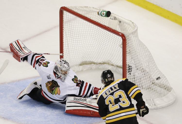 Boston Bruins center Chris Kelly scores past Chicago Blackhawks goalie Corey Crawford during the first period. (Charles Krupa / The Associated Press)