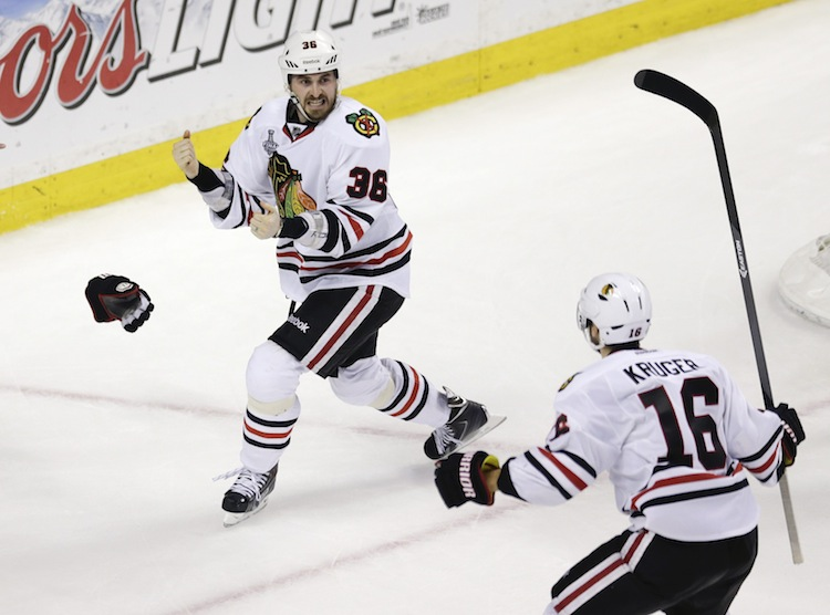 Chicago Blackhawks center Dave Bolland (36) celebrates his game-winning goal against the Boston Bruins with Chicago Blackhawks teammate Marcus Kruger late in the third period. The Blackhawks trailed 2-1 with less than two minutes to play before scoring twice and winning 3-2. (Charles Krupa / The Associated Press)