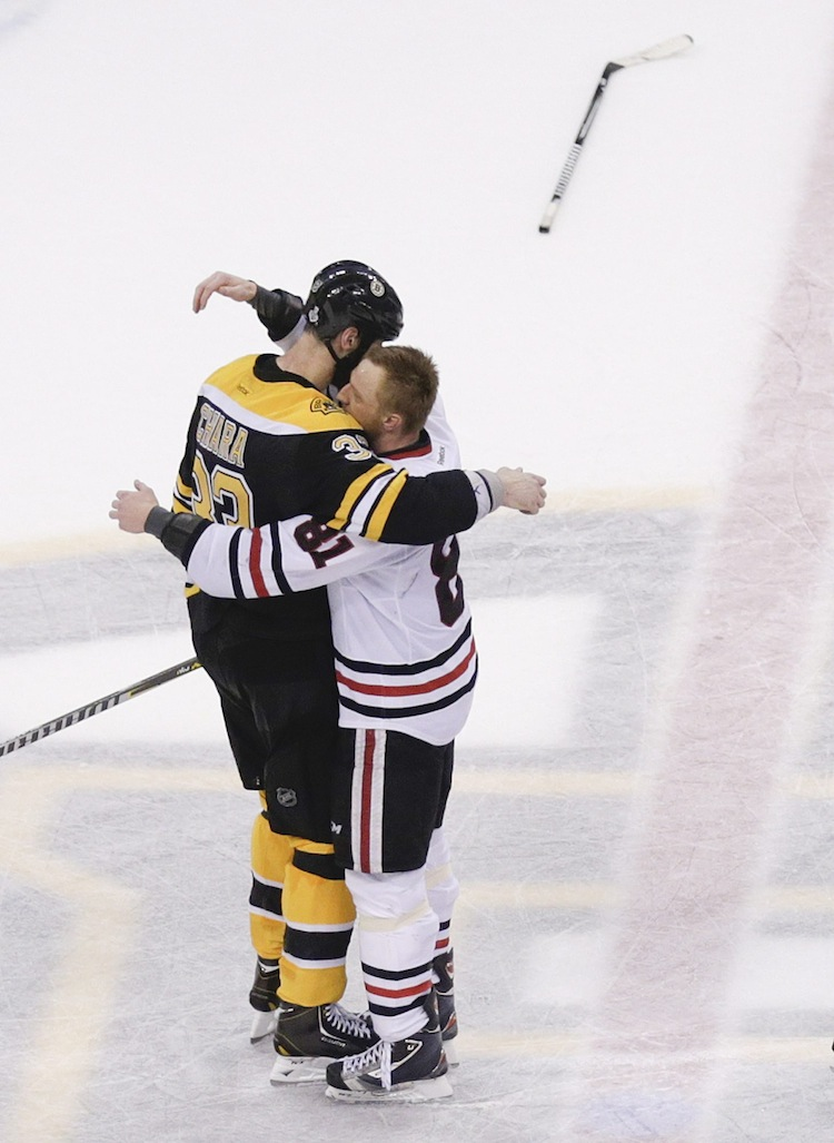 Boston Bruins defenceman Zdeno Chara (left), hugs fellow Slovakian/Chicago Blackhawks winger Marian Hossa during the post-game handshake.