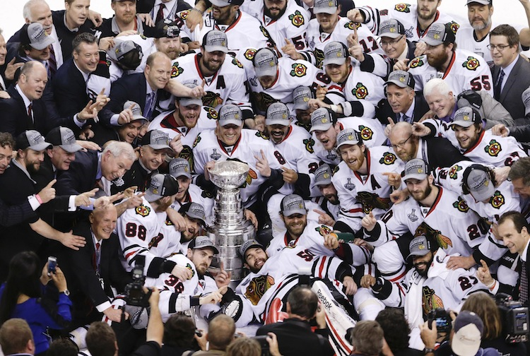 The Chicago Blackhawks pose with the Stanley Cup. (Charles Krupa / The Associated Press)