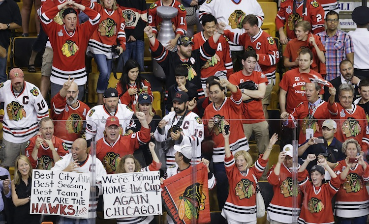 Chicago Blackhawks fans at TD Garden in Boston cheer after their team beat the hometown Bruins. (Charles Krupa / The Associated Press)