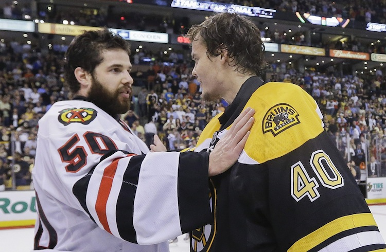 Chicago Blackhawks goalie Corey Crawford (left) is congratulated by Boston Bruins goalie Tuukka Rask.
