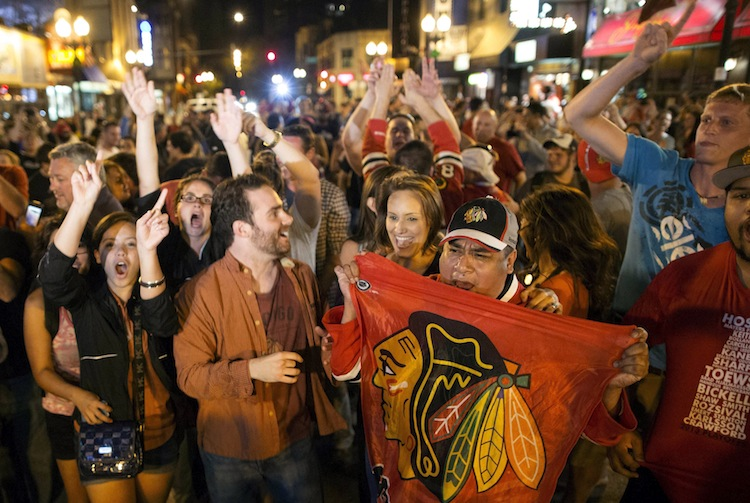 Fans celebrate on West Division Street in Chicago Monday after the Chicago Blackhawks won the Stanley Cup.