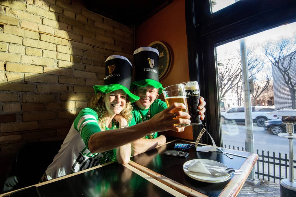 Di and Jim McDougal hoist some pints as they celebrate St. Patrick's Day at the King's Head on Wednesday evening.