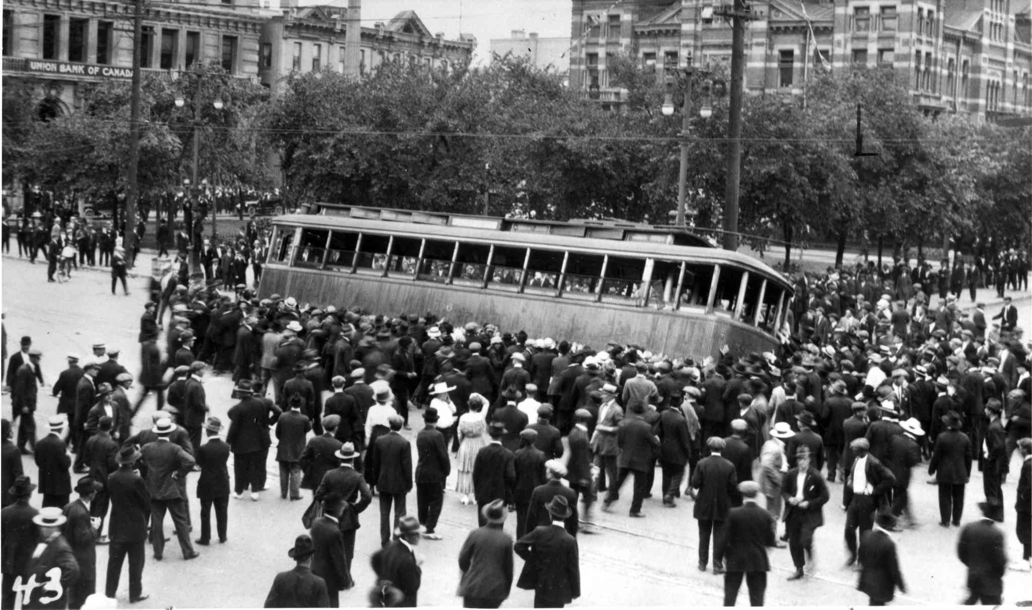 1919 Winnipeg general strike street car streetcar overturned on Main Street in front of the old City Hall building (Winnipeg Free Press)