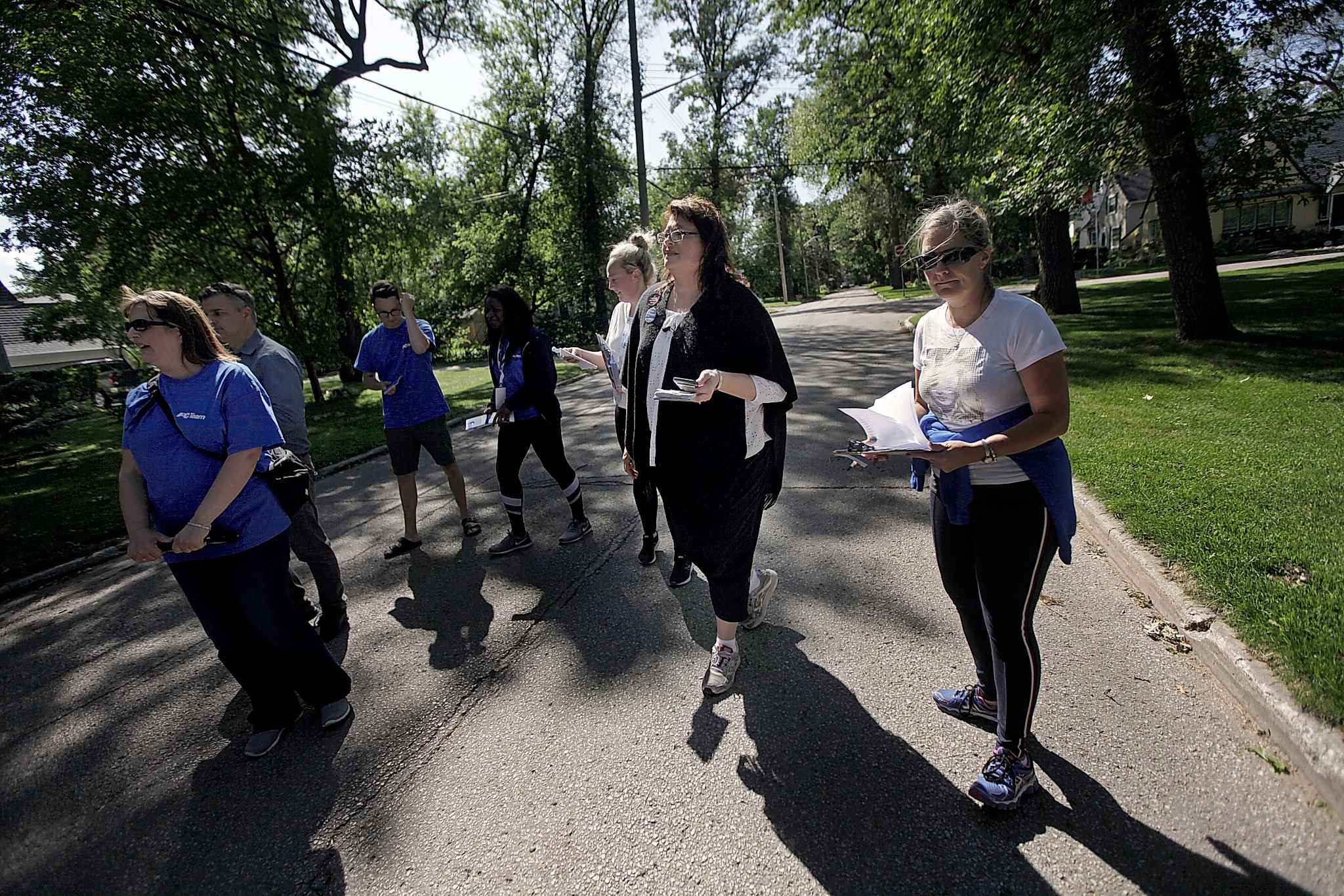 Incumbent St Vital MLA and Progressive Conservative candidate Colleen Mayer pounds the pavement along Kingston Row Thursday with members of her team.