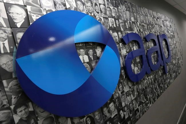 The logo of Australian Associated Press is seen in its Rhodes headquarters in Sydney, Tuesday, March 3, 2020. National news agency Australian Associated Press announced on Tuesday that it is closing after 85 years. (Danny Casey/AAP Image via AP)