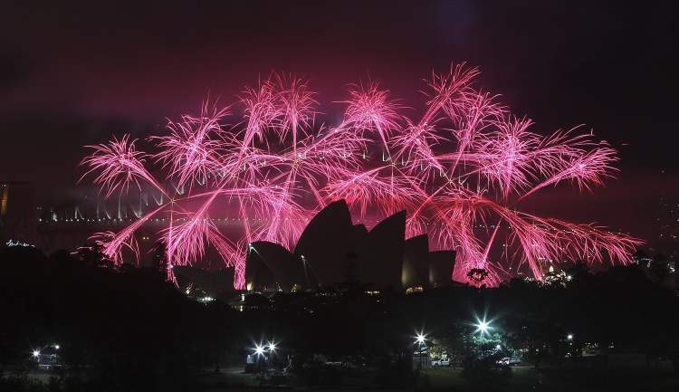 Fireworks explode behind the Opera House during the New Year celebrations in Sydney, Australia, Tuesday, Jan. 1, 2013. (The Associated Press)