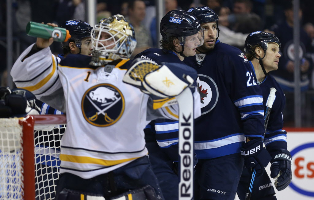 Winnipeg Jets' Devin Setoguchi (obscured), rear left to right, Jacob Trouba, Chris Thorburn and Olli Jokinen celebrate after Trouba scored on Buffalo Sabres' goaltender Jhonas Enroth (#1) during second period at the MTS Centre. (Trevor Hagan / The Canadian Press)