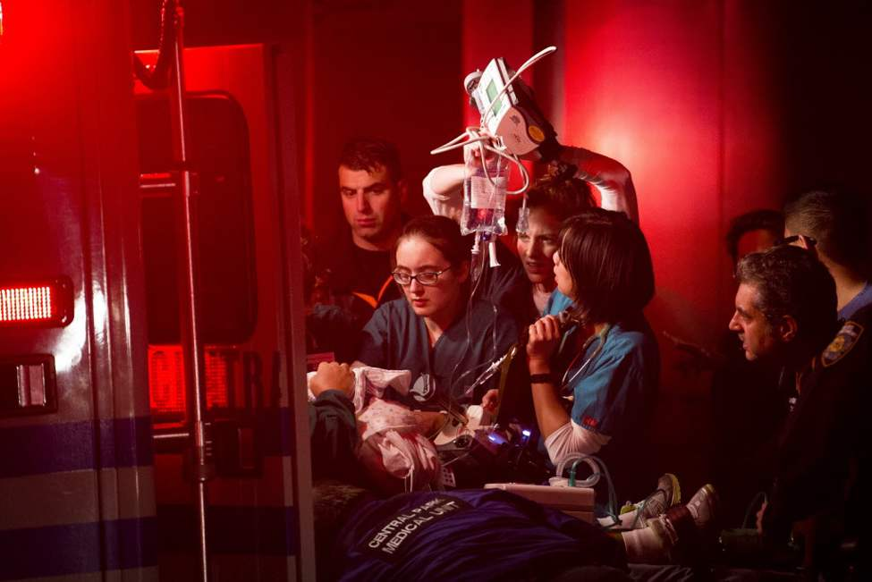 Medical workers assist a patient into an ambulance during an evacuation of New York University's Tisch Hospital, Monday  in New York. The New York City hospital is moving out more than 200 patients after its backup generator failed when the power was knocked out. (AP Photo/ John Minchillo)