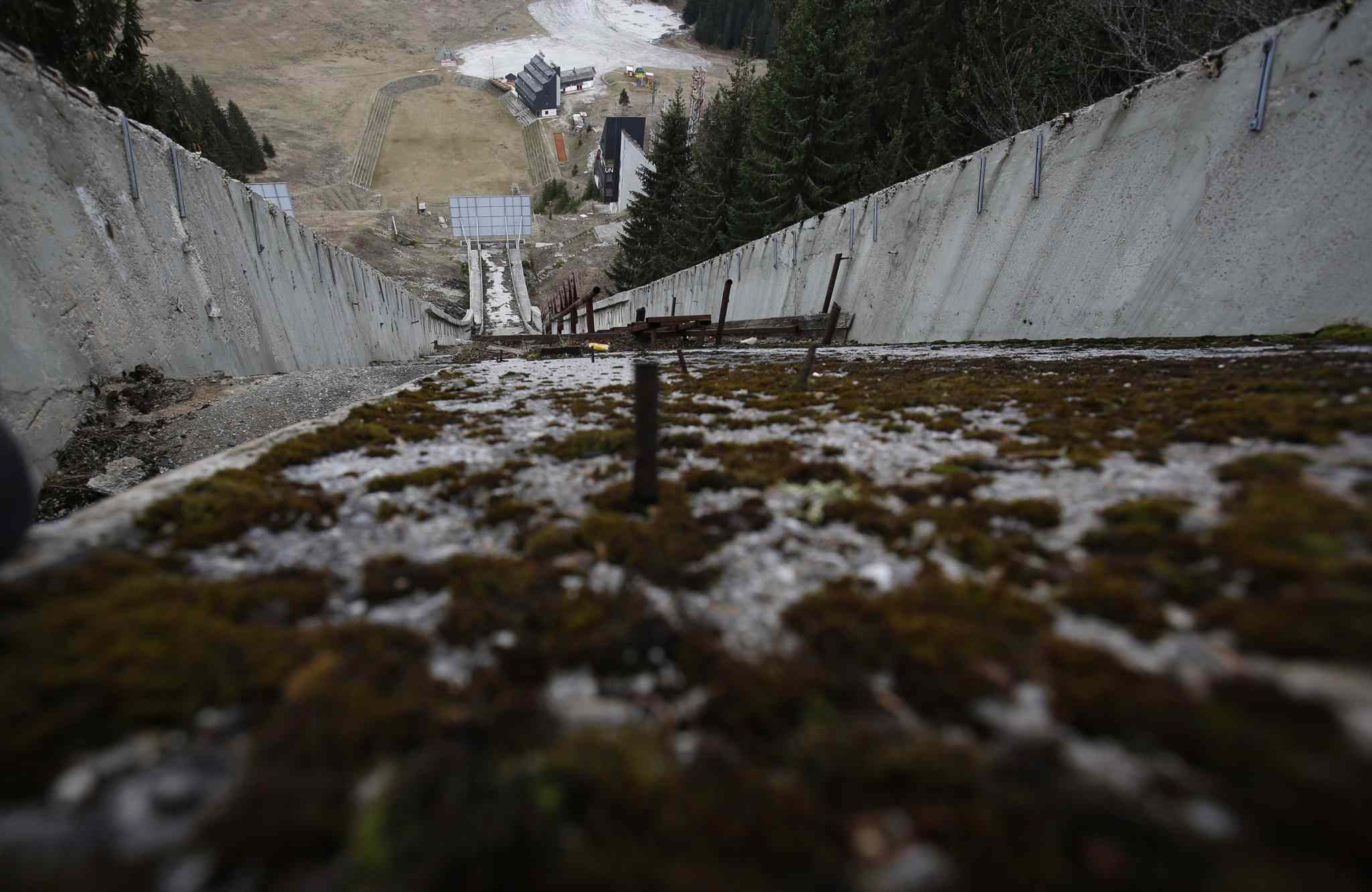 The abandoned ski jumping facility is seen covered in moss at Mt. Igman near Bosnian capital of Sarajevo.  Just eight years after the 1884 Olympics, the bobsleigh and luge track on Mount Trbevic was turned into an artillery position from which Bosnian Serbs pounded the city for almost four years. Today, the abandoned concrete construction looks like a skeleton littered with graffiti.