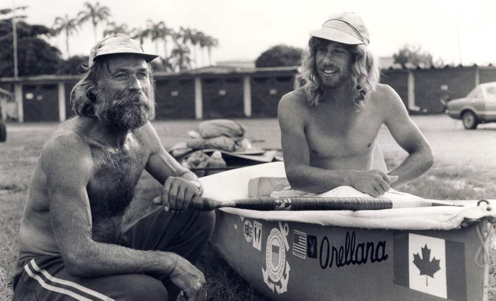 Don Starkell and son Dana pose with canoe in Panama Canal Zone before embarking for the Colombian Coast.  September 24, 1981