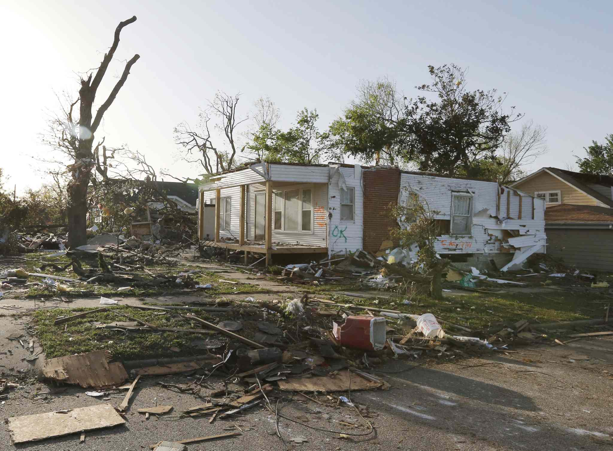 A home damaged by a tornado stands without a roof in Baxter Springs, Kan., Monday, April 28, 2014.
