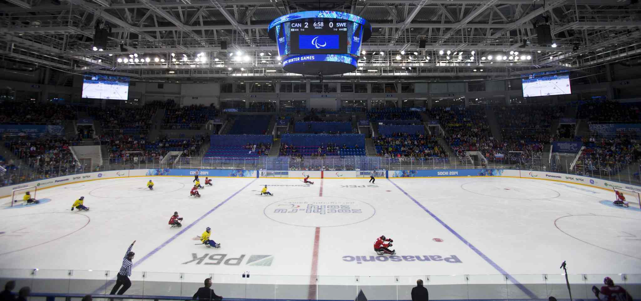 Teams of Canada and Sweden in action during the ice sledge hockey match at the Shayba Arena at the 2014 Winter Paralympics in Sochi, Russia, Saturday, March 8, 2014. Canada went on to win the match 10-1.
