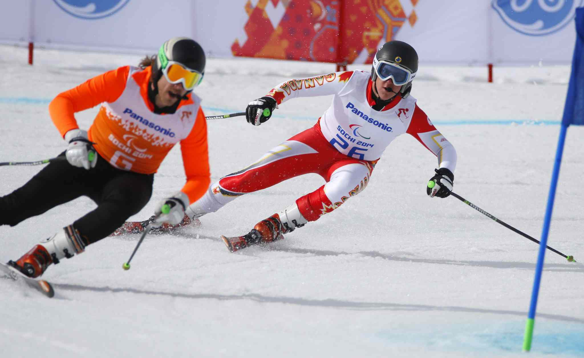 Mac Marcoux of Canada, right, and his guide Robin Femy race to win 3rd place in the men's downhill, visually impaired event at the 2014 Winter Paralympic, Saturday, March 8, 2014, in Krasnaya Polyana, Russia.