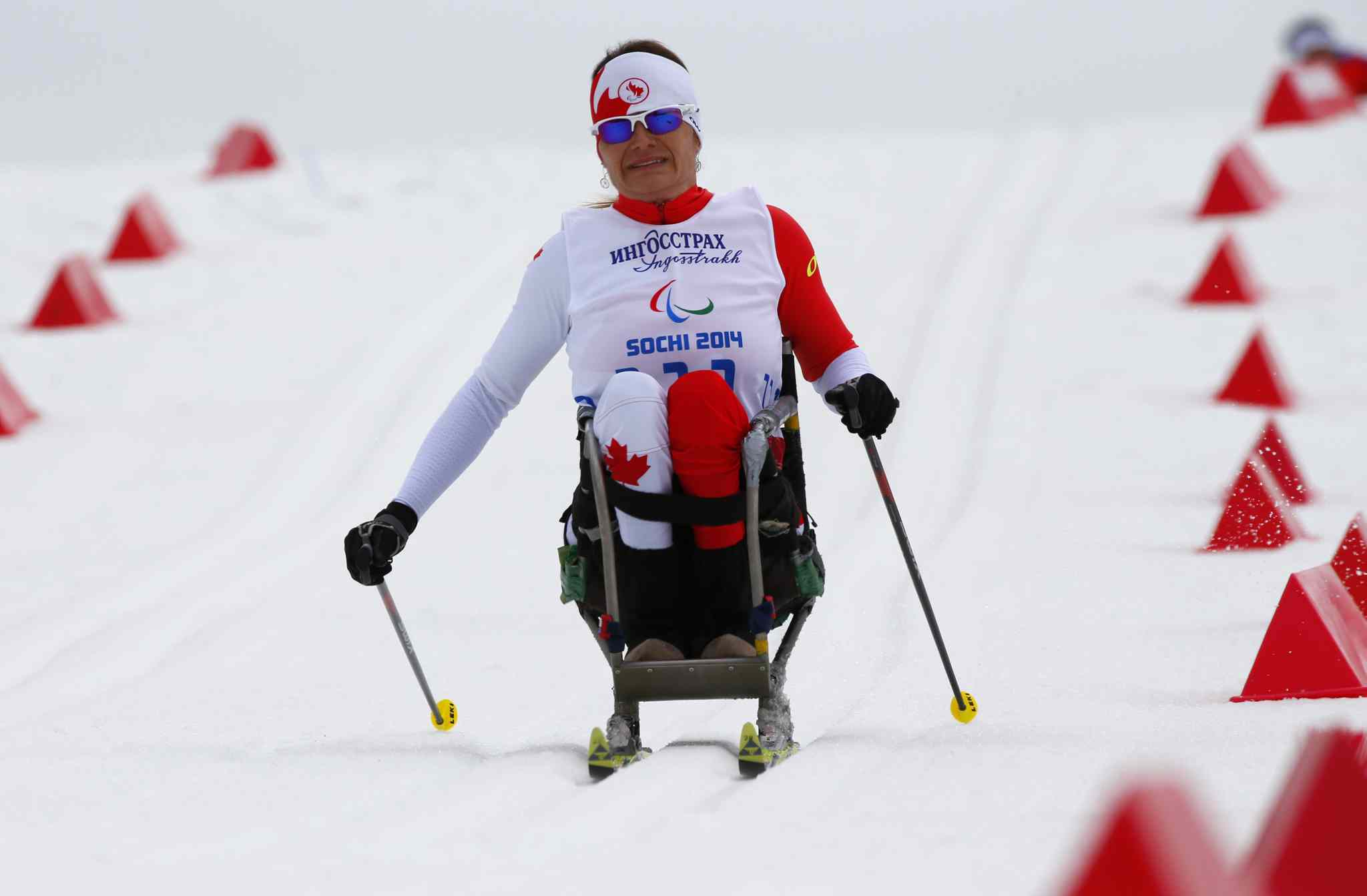 Colette Bourgonje of Canada races during the ladies 12km cross country ski, sitting event Sunday, March 9, 2014, in Krasnaya Polyana, Russia.