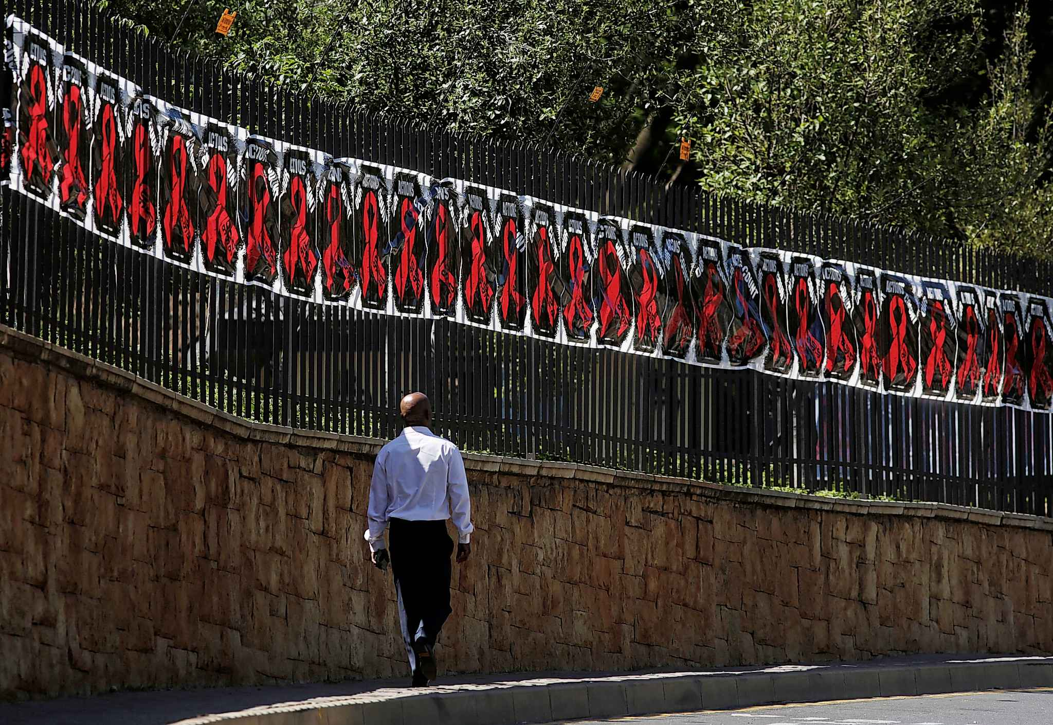 A man on Friday in Johannesburg, South Africa, celebrated the World Aids Day. (Denny Farrell / Associated Press)