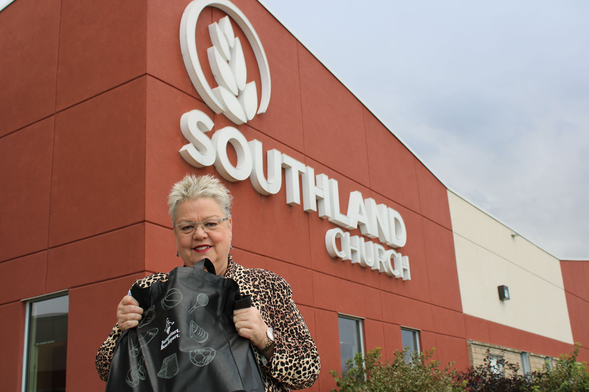 Southland Church Seniors Ministry Pastor and organizer of the Thanksgiving Food Drive, Grace Hiebert, holds a bag containing part of a hamper that will be given out Oct. 16. Fresh items such as fruit and bread will be added to the bags.