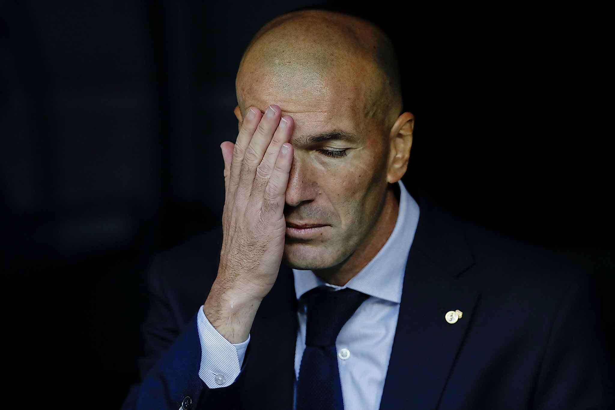 Try to stop touching your face, unless you are Real Madrid's head coach Zinedine Zidane and can't help yourself. (Manu Fernandez / The Associated Press files)