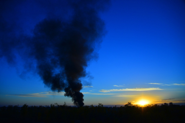 Smoke from the fire is seen at sunset from the Lagimodiere bridge.