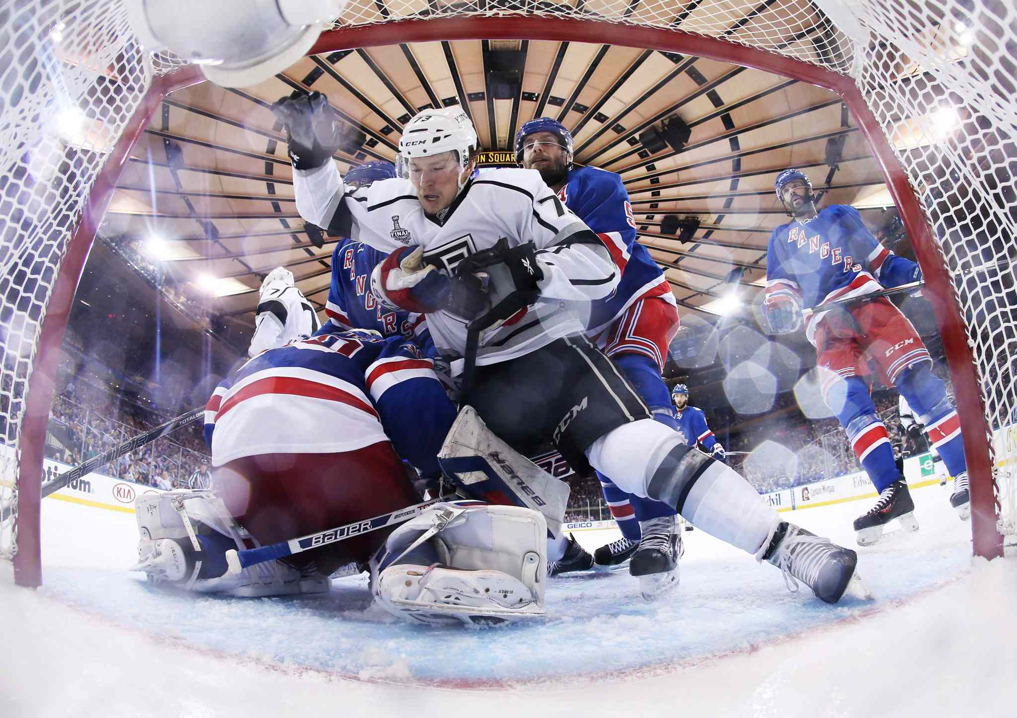 New York Rangers' defenseman Dan Girardi (5) grabs Los Angeles Kings centre Tyler Toffoli (73) as he falls toward the net in the third period of Wednesday's Game 4 of the Stanley Cup finals. The Rangers won 2-1.