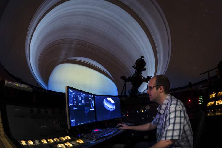 Animator Sean Workman at the controls of the new Digistar.