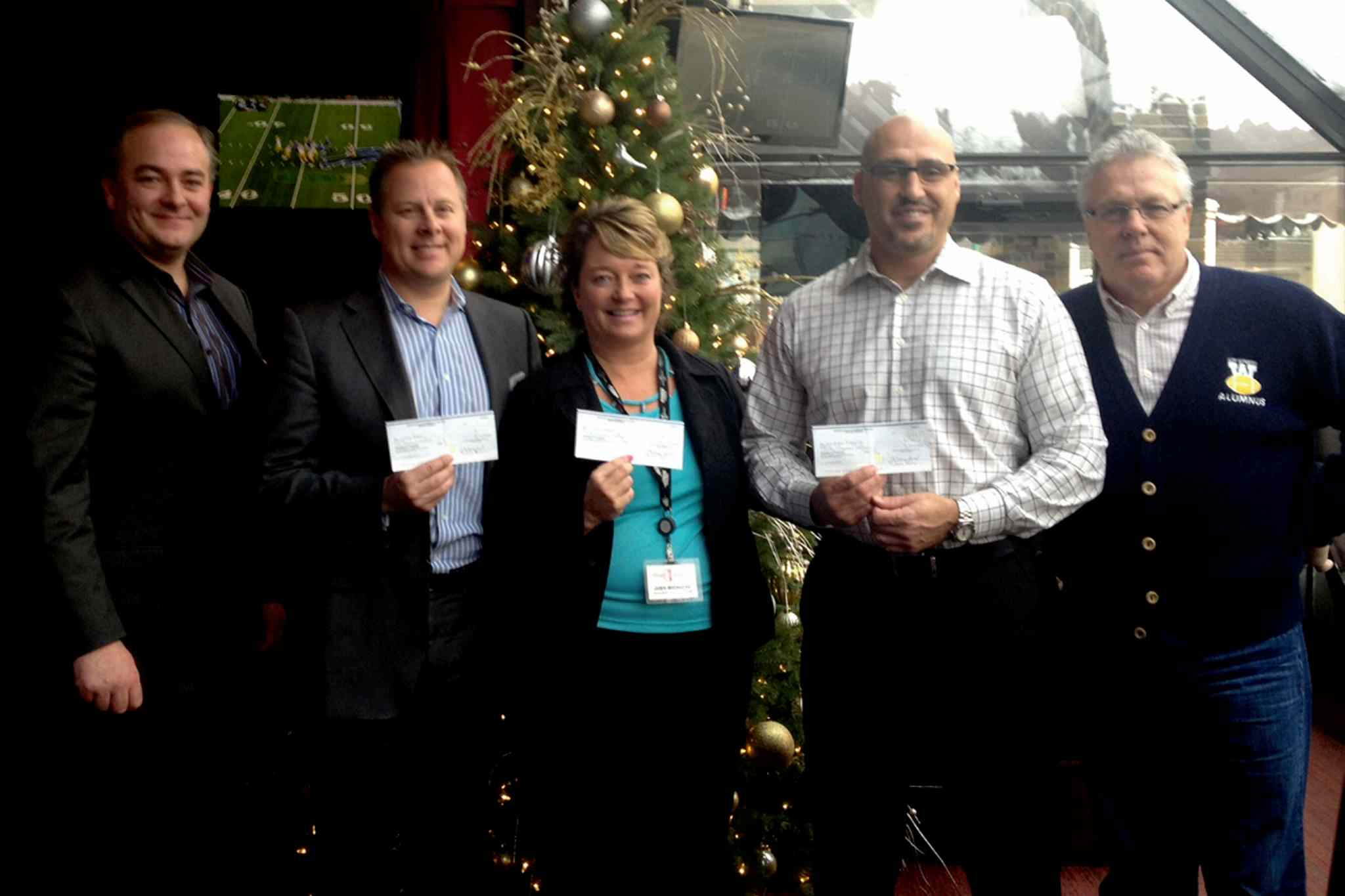 (Left to right) Anthony Wiebe of Scotiabank, Doug Warkentin of Little Heroes, Judy Richichi of Siloam Mission, Jayson Dzikowicz of Blue Bombers Alumni and Paul Bennett, chair of the Manitoba Heroes committee.