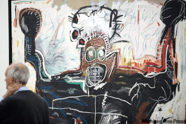 "The artwork of Jean-Michel Basquiat titled ""Boxer"" (1982, acrylic and oilstick on linen), pictured in the Fondation Beyeler in Riehen, Switzerland. The exhibition with the artwork of American artist Jean-Michel Basquiat (1960-1988) can be seen from May 9 until September 5, 2010."